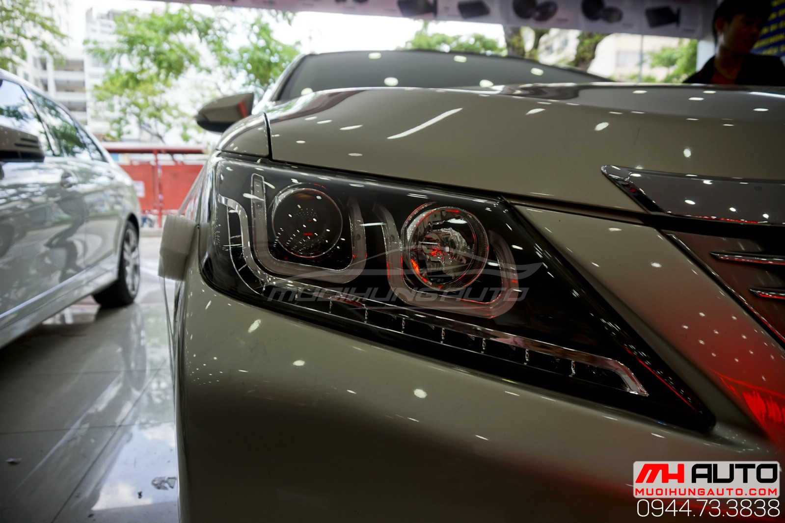 Xe Camry 2014 thay đèn nguyên cụm kiểu BMW